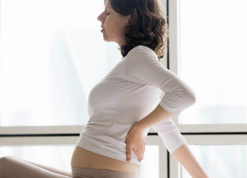 During pregnancy, how can lower back pain be managed